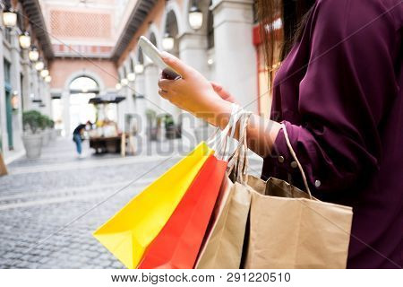 Woman Holding Shopping Bag And Using Smartphone For Shopping Online, Shopping Concept.