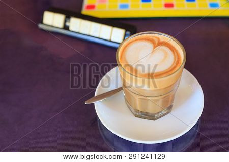 Hot Brown Caffe Latte Coffee Decorated With Heart Froth Art On Steamed Milk Foam In Glass On Rustic