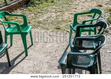 A Plastic Garden Chairs Placed To Talk