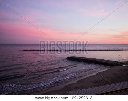 Pier Over Sea In The Sunset Sky