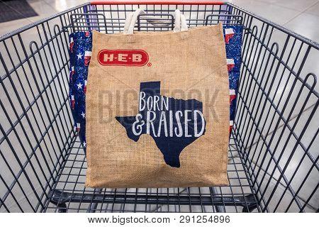 San Antonio, Texas - November 9, 2018 - Shopping Cart With H-e-b Reusable Shopping Bag With The Texa