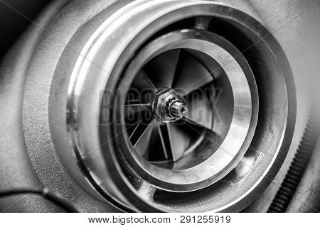 Close Up Detail Of A Diesel Engine Turbocharger With Fan Blades And Center Axle - Selective Focus On