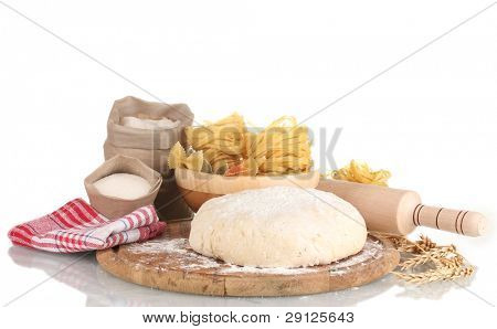 ingredients for homemade pasta on wooden plate isolated on white