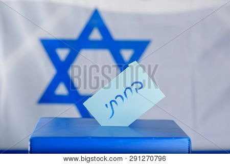 Vote Box On Election Day. Hebrew Text I Voted On Voting Paper Over Israel Flag Background. Freedom D