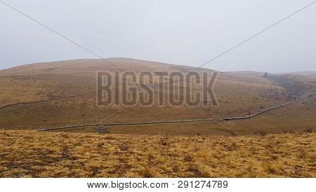 A Barren Plateau In The Autumn Fog, Yak Meadow In The Yulong Snow Mountain, Lijiang, Yunnan, China