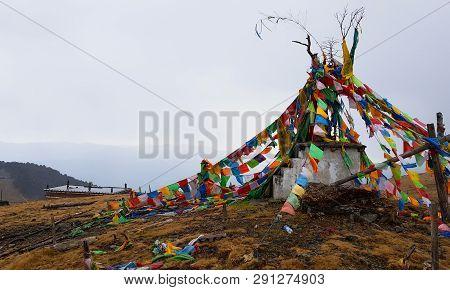 Buddhist Prayer Flags In Yak Meadow In The Yulong Snow Mountain, Lijiang, Yunnan, China