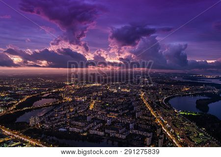 Drone Shot Over Megapolis After Sunset. Night Lights Of The Big City Aerial View.