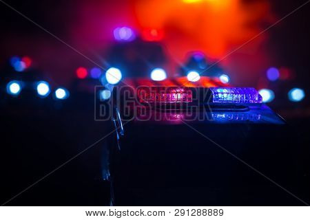 Police Cars At Night. Police Car Chasing A Car At Night With Fog Background. 911 Emergency Response