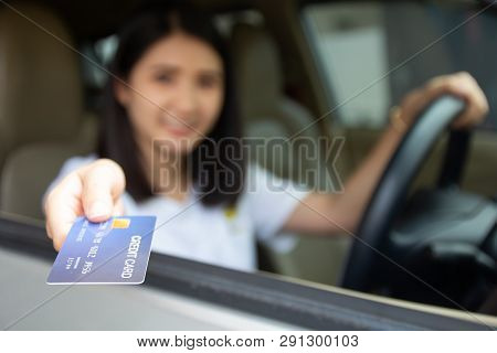 Young Asian Girl Driving Car Hand Holding Credit Card Payment For Gas. Woman Car Owner Paying Fuel P