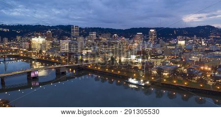 The City Skyline Glows At Dusk In This Aerial View Of Portland Oregon