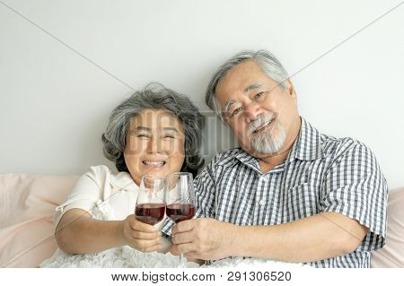 Happy Love Elderly Couple Smile Holding A Wine Glass , Senior Couple Old Man And Senior Woman Relaxi