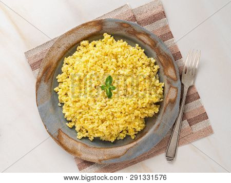 Bulgur Wheat. Boiled Bulghur Cereal In Plate On White Marble Table. Healthy Vegetarian Food, Top Vie