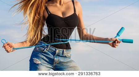 Athletic Slim Woman Measuring Her Waist By Measure Tape After Diet. Slim Body, Jump Rope. Girl With