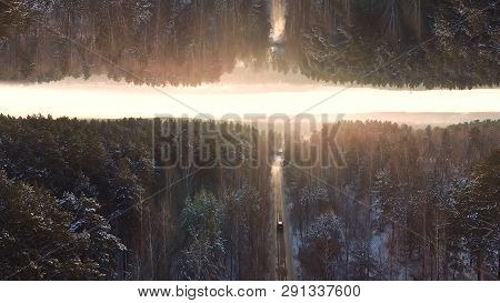 Car Driving On Winter Country Road In The Forest, Aerial View On Sunset Sky Background, Mirror Horiz