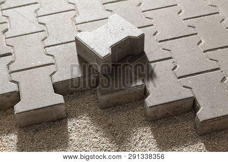 Building An Pedestrian Path With Paver Bricks. Sidewalk Pavement