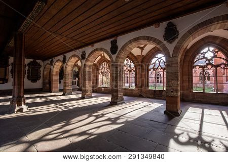 Basel, Switzerland - March 10, 2019: The Cloister At The Basel Minster. The Basel Minster Is One Of
