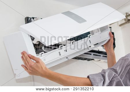 Service Man Is Cleaning, Repair And Maintenance Of Air Conditioner