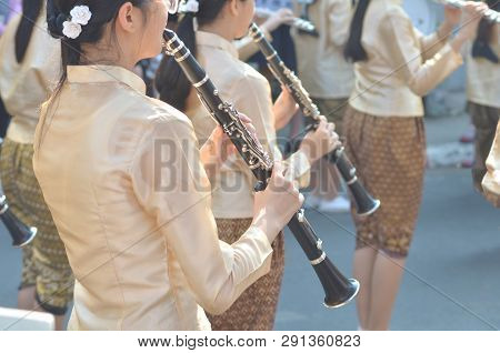 Young Girl Wear Thai Traditional Suit Playing Clarinet For Show In Marching Band Paraded On Street W