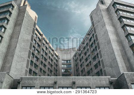 Huge Symmetric Concrete Skyscraper With Sky, Toned Image