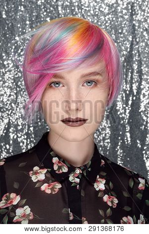 Young Beautiful Girl With Freckles. Colored Hair, Blue, Yellow, Red, Lilac And Pink. Pixie Bob Hairc