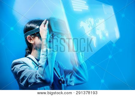 Asian Female Doctor Looking At Digital Interface With Virtual Reality Device Display The World Map,