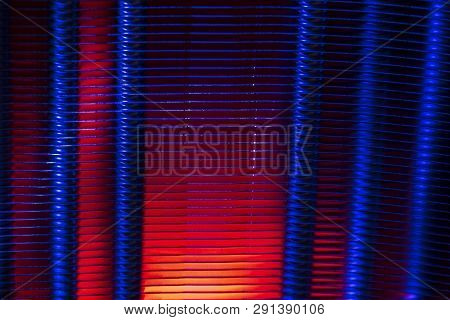 Ribbed Metal Surface Of Radiator In Dual Color Light. Heating Equipment. Grunge Abstract Background