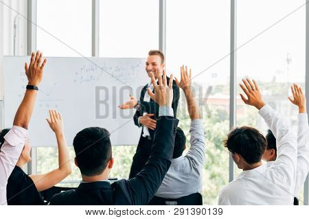 Many Business People Participants Raising Up Their Hand In Business Seminar Conference Event Inside