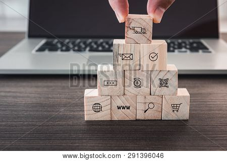 Business E-commerce And Shopping Media Icons Concept, Closeup Finger Man Is Pick Up Wooden Cube From