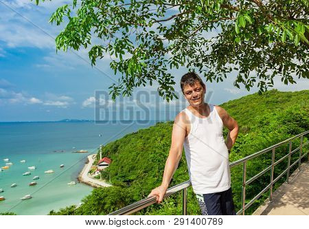 A Man At A Lookout Point On The Island Of Koh Larn