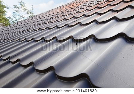 Metal Roof. The Use Of Roofing Materials In The Construction Of The Building.