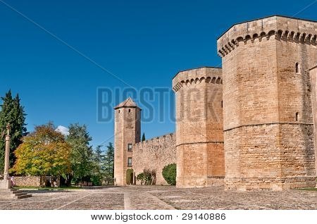 Fortified Wall and square in Front of Poblet Monastery, Tarragona Province, Catalonia, Spain.