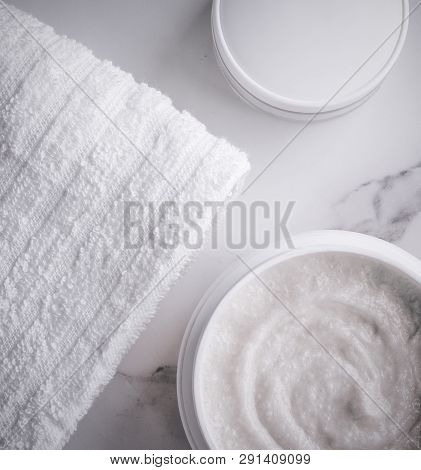 Skincare and body care, luxury spa and clean cosmetic concept. Health and beauty of your skin - Scrub and exfoliating cream products on a marble, flatlay poster