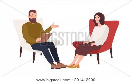 Female Patient In Armchair And Male Psychologist, Psychoanalyst Or Psychotherapist Sitting In Front