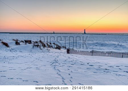 Winter Lake Sunset Landscape. Sunset Horizon Over A Snowy Lake Michigan Coast At Sleeping Bear Dunes