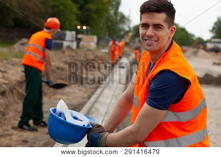 Handsome Young Road Construction Worker In Orange Safety Jacket