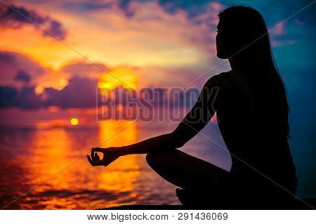 Woman Meditating, Relaxing In Yoga Pose At Sunset, Zen Meditation