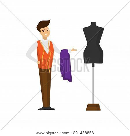 Tailor Standing With Cut Of Fabric And Measuring Tape And Pointing Hand At Mannequin