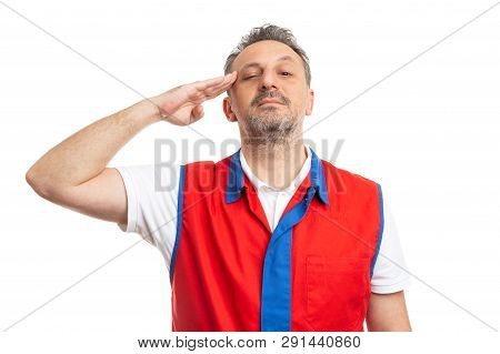 Serious Male Hypermarket Or Supermarket Employee Wearing Red And Blue Vest Touching Temple With Hand