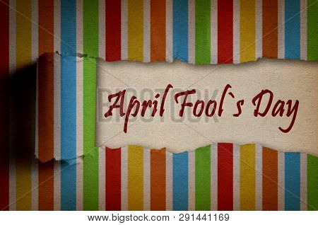 April Fool 's Day Written Under Torn Colorful Paper