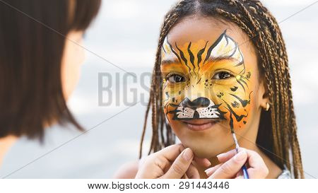 Kids Facial Art. Little Girl Getting Her Face Painted By Face Painting Artist Like Tiger, Free Space