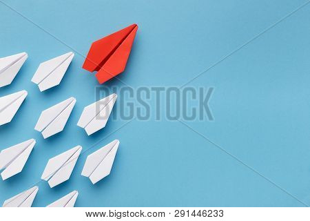 Leadership Concept. Red Paper Plane Leading Group Of White Ones, Going To Aim, Blue Background With