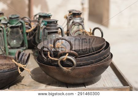 Uae, Dubai - January, 2019: Trolley With Old Styled Tableware And Lanterns At Arabic Market In Al Se