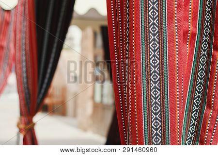 Uae, Dubai - January, 2019: Tent With Curtains In Traditional Arabic Style - Handmade Sadu Of Bright