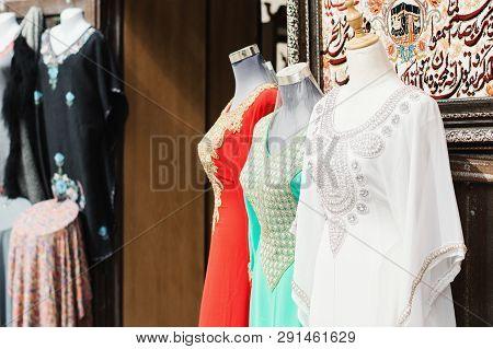 Uae, Dubai - January, 2019: Traditional Arab Dresses At Gift Shop In Al Seef Area. Arab Souk
