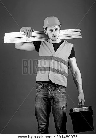 Construction And Woodworking Concept. Carpenter, Woodworker, Labourer, Builder On Dreamy Face Carrie