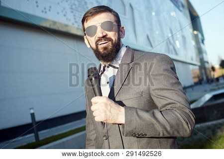 The Bearded Anchorman With Microphone Is Presenting Daily News In Live Program At The Street.