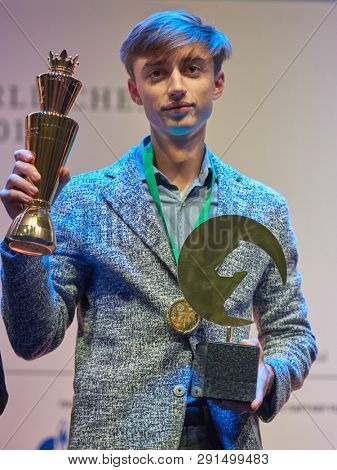 ST. PETERSBURG, RUSSIA - DECEMBER 30, 2018: Grandmaster Daniil Dubov, Russia holding the golden cup of World Rapid Chess Championship 2018 during award ceremony