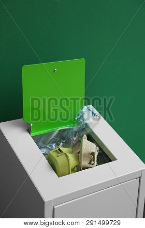 Overfilled Trash Bin On Color Background. Recycling Concept