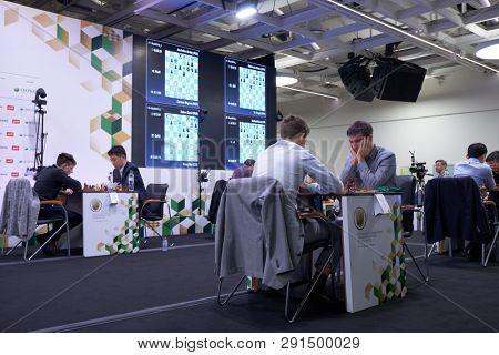 ST. PETERSBURG, RUSSIA - DECEMBER 28, 2018: Match Dmitry Andreikin, Russia (right) vs World Champion Magnus Carlsen, Norway during King Salman World Rapid Chess Championship. Carlsen won the match