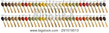 Various Spices And Herbs Poured Into A Wooden Spoon. Seasonings For Food Isolated On White Backgroun